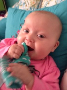 My baby sister eating her sock