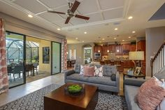 The large Grand Room opens up to the Lanai (screened porch) in our Granada model home in The Reserve neighborhood in Tampa. New Homes, Living Room