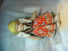 This doll was sold by Liberty of London, to raise funds for the Polish Community.    Her arms and legs are of velvet, and her blonde hair hides beneath a traditional yellow scarf.  Under the red flowered skirt and brown velvet waistcoat is white underwear.  Newton Abbot's has strong connections with the Polish Community .  Following WW2 Stover was converted into homes for the Polish refugees.    This doll was one of 47 in the U.K., and is now the last of its kind.