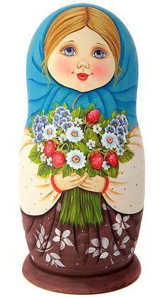 Matryoshka (Russian nesting doll) in a blue shawl