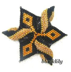 Twisted Star by Blacklily, with pattern on linked page. Geometric peyote stitch.