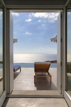 This summerhouse on the island of Syros is defined by clear and square volumes and blends in with the Cycladic landscape, offering spectacular views of the Aegean.