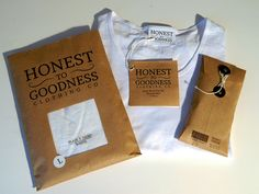 Honest To Goodness Clothing Packaging on Behance...Love the paper bag look with the clear acetate window.  Clever...