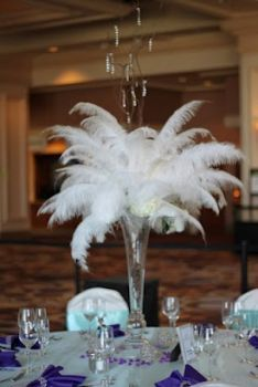 Feather and hydrangea arrangements with dangling crystals - Classic Vegas; Caitlin Arnold Weddings and Events