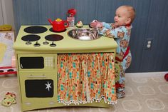 Old TV stand into a play kitchen