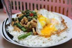 This is fast food in Thailand. Basil stir-fry with your choice of chicken, pork or beef, served over rice and topped with a friend egg. All for around $3. I miss Thailand!