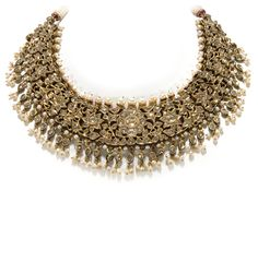 A gold necklace of joined open worked segments kundan set with table cut diamonds and crowned with Basra pearls. -