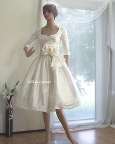 Marianne - Vintage Inspired Wedding Dress. Not a big fan of the bow, but a blue sash would be gorgeous!