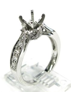 Ladies 14kt white gold semi mount. Mounted in ring are 26 brilliant round cut diamonds weighing a total of .42ct. The head can be changed to take any size round diamond in the center.