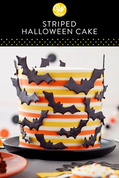 Shock and surprise your Halloween guests with this bat-tastic Striped Halloween Cake. Comb your cake to create evenly spaced indents, then fill in the grooves with orange and yellow frosting before smoothing out the sides. Attach some candy bats for a fun Halloween Cake Pops, Halloween Desserts, Halloween Torte, Bolo Halloween, Pasteles Halloween, Halloween Treats, Halloween Cake Decorations, Holloween Cake, Halloween Birthday Cakes