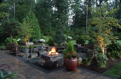 Custom Outdoor Fire Pits - Gallery   Alderwood Landscaping Woodinville, Washington  Fire Pit with Natural Rock Seating
