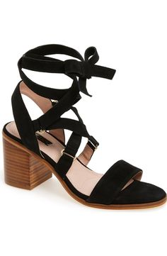 Soft suede straps crisscross and lace around the ankle of this chic summer sandal from Topshop.