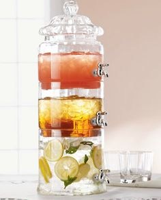 Love this glass beverage dispenser, it's gorgeous and very functional.  - via Preston Bailey