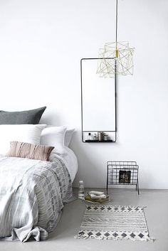 Black iron wall mirror with shelf