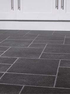 The dark slate color and different size tiles is very cool.