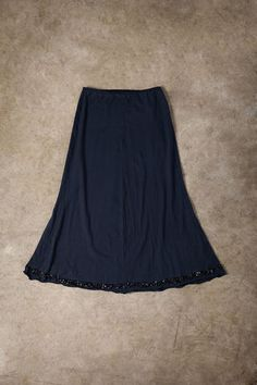 organic lightweight cotton jersey Beaded Mid-Length is hand sewn in a single layer and features cluster armor beading along the hem. Mid Length Skirts, Dry Hands, Black And Navy, All Sale, Hand Sewn, Alabama, Beading, Ships, Organic