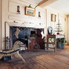 Another feather tree, and a swag of silver tinsel, decorate the fireplace wall in the dining room.~♥~