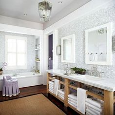 The marble mosaic tiles of this master bedroom  were purchased at a hotel salvage sale