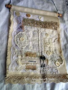 Isn't this gorgeous? Love the layout and the lace at the bottom. A larger wallhanging for our bedroom would be nice..