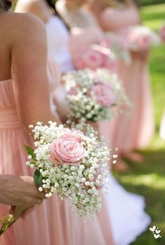 Bridesmaids with baby's breath and soft roses to match their dresses.  #WeddingIdeas #WeddingFlowers