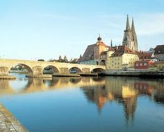 Regensburg.  Germany's best preserved medieval city as well as home to  Historische Wurstkuch'l.  Oldest known bratwurst maker:)