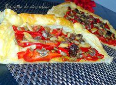 Hojaldre de pimientos rojos fritos con pasas, pipas y piñones