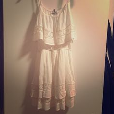 Country Dress Bought from online boutique for wedding.. Never worn. Have receipt too! Size small. I am 5 4 and it came right underneath the butt area.. Might be great on someone shorter. Cute with cowboy boots!  Dresses