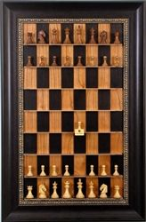 "Vertical Straight Up Chess sets. They hang on the wall like Art but designed for a casual game of chess as you pass by. Make your move, mark it with the ""Last Move"" marker and go on your way. A classy decoration for man cave, game room, family room, hallway, entry, bedroom, office, etc. This is the Black Cherry Board with Dark Bronze frame and  Columbian Chess Pieces. www.straightupchess.com"