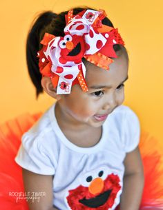 Elmo Bow -- Elmo Over The Top Bow -- red, orange and white polka dots with matching headband on Etsy, $19.95