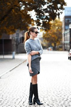 Grey sweater and pencil skirt with black boots. Great for a cold work day