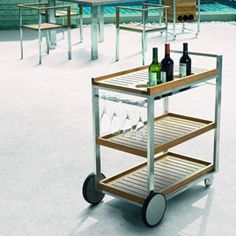 The elegant BIBI Cart holds modern simplicity in its function. A slight, stainless steel frame & layers of superior quality teak evenly spaced provide easy access to beverages & glassware. BIBI design for Jane Hamley Wells.