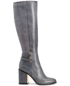 Calvin Klein Women's Caime Tall Boots $279.00 Calvin Klein's Caime tall boots have the form and function for fashionable everyday war. A metallic plate at the front of the heel sets this silhouette apart.