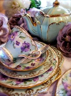 Pastel pansies on light blue with gold accents.