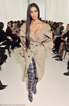 Braless Kim Kardashian in off-the-shoulder trench coat at Balenciaga PFW | Daily Mail Online