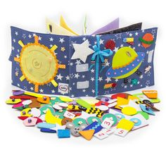 Quiet active book made of cloth is recommended for children from 1 year old. It consists of 7 sheets. On every of 12 pages there are different kinds of clasps:  -Velcro  -Buttons  -Knobs  -Shoelaces  -Zipper  -Pins  -Yarn  The hardcover of the quiet active book also contains developing elements on Velcro, mini maze with a ladybird, buttons and ribbons. You can enter any title of the book.  Textile developing book is fastened by plenty of stitches inside. After production all details and the…