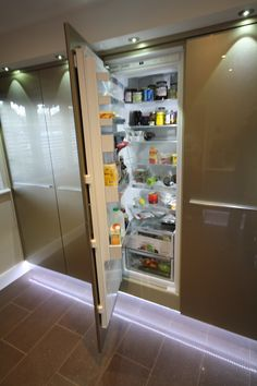 """Kitchen Style – Bespoke Metallic Vetra tempered glass units in Champagne, with Champagne glass splash backs and Caesarstone work surface """"Dreamy Marfil"""" Integrated Fridge, Glass Front Cabinets, Work Surface, French Door Refrigerator, Freezer, Kitchen Ideas, Champagne, New Homes, Kitchen Appliances"""