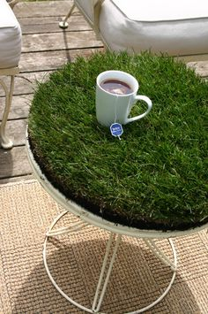 One pinner said:I'd love to make my outdoor space more inviting.  This feels like a fun start: a piece of grass sod is cut to fit a table that has drainage.