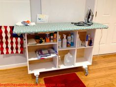 Institches with Bonnie: ironing board  on top of a shelving unit with casters. lots of storage room under the board