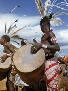 Africa | Wakamba Man Beats a Drum with His Hands for a Dance. Kenya. | ©W. Robert Moore