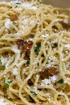 "Spaghetti Aglio e Olio | ""This is one of the first dishes my Italian MIL taught me to make! She told me this was an important dish to know as it is tasty, very economical and you can clean out the fridge using up leftovers. Boy was she right!"" #pasta #pastarecipes #pastainspiration #pastadinner #pastaideas #pastadinner #pastaideas"