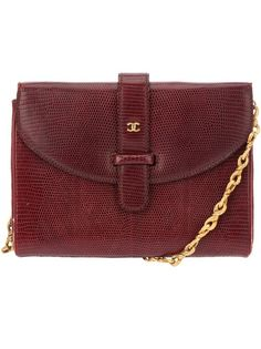 Red lizard skin shoulder bag from Chanel featuring a front flap with strap fastening, a signature gold tone logo, a chain shoulder strap and an interior pocket with metallic brand logo. Please note: this item cannot be shipped outside the E.U.  Please also note that vintage items are not new but often between 20 and 50 years old, and therefore will always have minor imperfections, even when the items have been used with love and care.