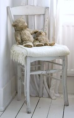 The special animals displayed on a side chair-the  kitty from Devorah and the bear from John and Sue...maybe in guest room.