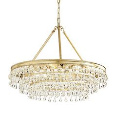 Our Layla Chandelier offers a sparkling modern take on the classic crystal fixture. Three tiers of teardrop and ball shaped glass crystals create the dramatic illusion of falling water from every angle. Layla Chandelier features: 8 lightsMolded steel frame