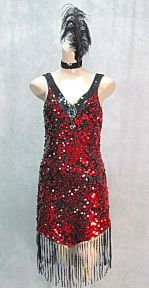 Red and black flapper costume has a sequined front with a big jewel bead at the V neck and tons of fringe around the hem. Headband with feather too.