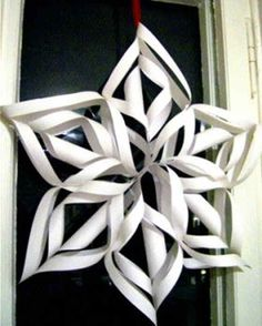 paper snowflake craft--we decorate with these in the Children's Room every winter! Diy Christmas Fireplace, Diy Christmas Snowflakes, 3d Paper Snowflakes, How To Make Snowflakes, Snowflake Craft, Snowflake Decorations, 3d Christmas, Christmas Decorations, Decoration Crafts