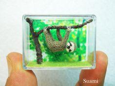 Miniature Grey Sloth  - Micro Crochet Dollhouse Amigurumi Animals - Made To Order by SuAmi on Etsy https://www.etsy.com/listing/108571250/miniature-grey-sloth-micro-crochet