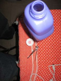 How to remove the cap on a Swiffer Wet-Jet cleaner bottle so you can refill with your own cleaner.