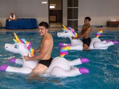 England footballers Jesse Lingard and Harry Maguire play with inflatable unicorns