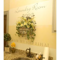 Dress up your laundry room with stencils and a flower arrangement.