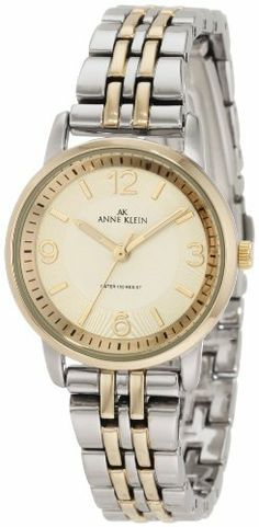Anne Klein Women's 10/9783IVTT Ivory Dial Two-Tone Bracelet Watch Anne Klein. $51.35. Ivory dial with gold-tone arabic 12-3-6-9 and stick markers at all other hour indexes. Two-tone 28mm round case. Two-tone adjustable link bracelet. Gold-tone skeleton hour, minute hands, sweep second hand;black printed outside minute track. Water-resistant up to 100ft.. Save 32% Off!